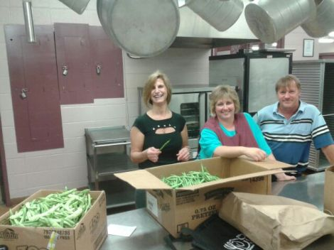 School food director and colleagues at the district central kitchen with Wood's Earth beans